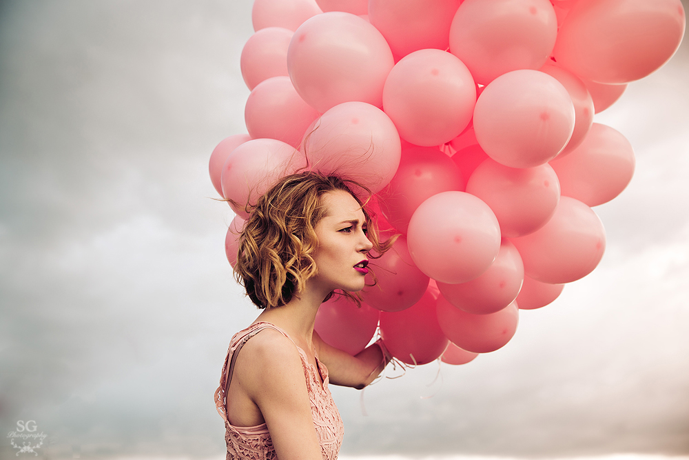 The girl with the pink ballons